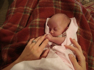 Sophie holding Lindsay's finger. She has a death grip. I think that would be an okay way to go... squeezed to death by a sweet baby!