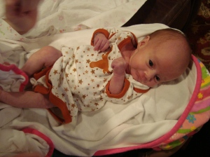 Hook 'em Horns! (As you can see, this onesie is still a bit too big for her. But she wanted to wear it to show it off!)